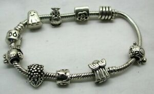 Genuine Pandora Silver Bracelet With Nine Silver Charms