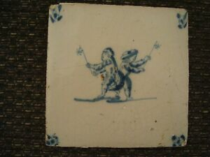 Antique Delft blue and white tile depicting 2 figures playing with toys  21/449B