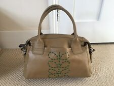 Tan coloured Orla Kiely handbag with green design
