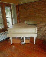 Baby grand piano, white, used.in good condition but needs to be tuned.