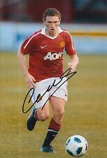 MANCHESTER UNITED HAND SIGNED CORY EVANS 12X8 PHOTO 2.