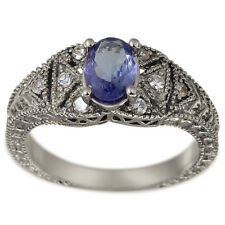 Tanzanite Ring In 14k White Gold With Milgrain Decoration And Diamond Accents