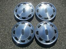 genuine 1984 to 1986 Mercury Marquis 14 inch hubcaps wheel covers set