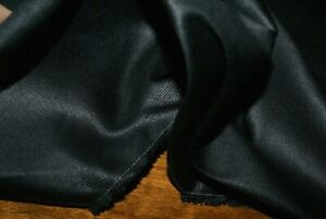 50cm x 157cm wide BLACK COTTON SATEEN SUITING FABRIC WITH GIVE (FAUX VINYL)