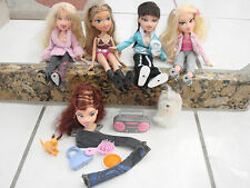 Bratz doll lot of 4 girls dolls dressed with extra pants, furry dog styling head