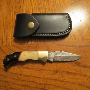 Damascus folding blade knife black & white bone handle, leather sheath hand made
