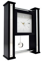 Modern Black Wood Silver Chome Base Wall or Mantel Clock with Moving Pendulum