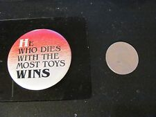 """""""He Who Dies with the Most Toys Wins"""" pinback pin vintage"""