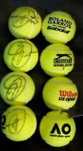 NOVAK DJOKOVIC SIGNED SET OF 4 GRAND SLAM BALLS-US-AUSSIE-FRENCH-WIMBLEDON