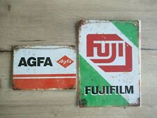 Fuji and Agfa metal wallet sign.  Two shields in perfect unopenend condition.