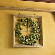 Wreath of artificial green apples framed in a white distressed picture frame