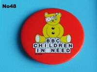 A collection of different Children in need pudsey bear pin badges charity