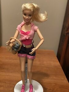 Mattel barbie doll 2013 with tennis shoe roller skates  and dog bendable