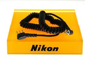 Nikon 3 prong coiled flash sync cable. EXC++ condition. Genuine product.