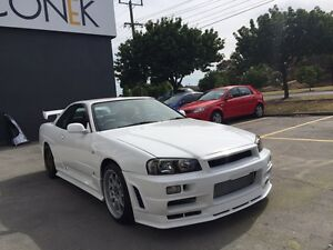 Skyline R34 GTR conversion east bear body kit. Full kit fitted and painted.