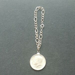 1964 KENNEDY HALF DOLLAR BRACELET, 90% Silver half dollar.