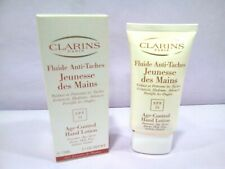 CLARINS FLUIDE MAINS ANTI-TACHES / AGE CONTROL HAND LOTION SPF15   75ML.