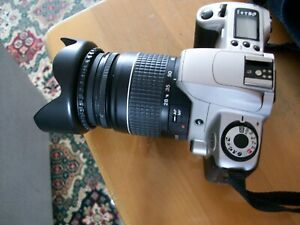 canon camera with lens and hood with book of instructions the focusing point box