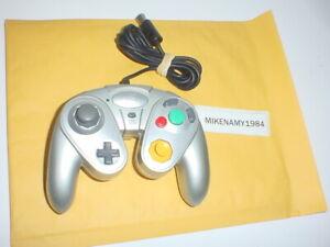 Pelican brand SILVER CONTROLLER for Nintendo GAMECUBE system.