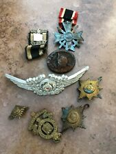quantity of ww2 german and english badges ( well used )