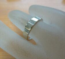 Bague or blanc 18 carats sertie de 9 diamants poincon tete d aigle T 56