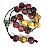 Greek komboloi with dark red and yellow marble colored beads and silver details
