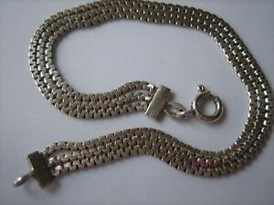 A Lovely Sterling Silver Triple Strand Bracelet and a Sterling Silver Ring.