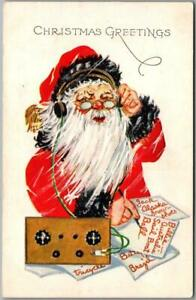 Vintage CHRISTMAS Embossed Postcard SANTA CLAUS w/ Headphones / Wireless Radio