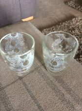 TWO VINTAGE APPROX 6cm TALL PATTERNED SHOT GLASSES IN GOOD CONDITION