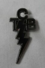 Elvis Presley Taking Care of Business TCB black enamel pin badge.
