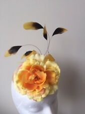 New Yellow flowered fascinator with feathers on a cream base. Gorgeous on!