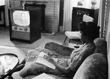 Photo. 1958. Arkansas.  African American Girl Watching Television