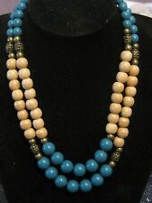 with pretty bronze tone metal fitting Wonderful wooden & plastic beaded necklace
