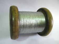 ANTIQUE VINTAGE WOODEN SPOOL WITH SILVER THREAD . HUGE