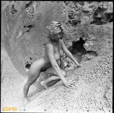 nude blonde girl climbing beside rock, vintage fine art negative, 1970's