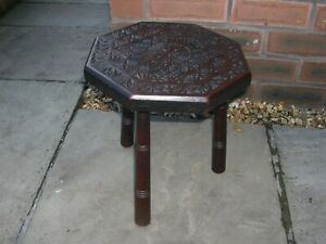 A lovely Arts and Crafts three legged stool with carved hexagonal seat.