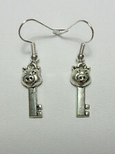 Dangle earrings - pig face key