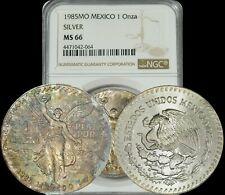 1985-MO Mexico Silver Libertad 1 Onza NGC MS66 Multi Color Toned Coin