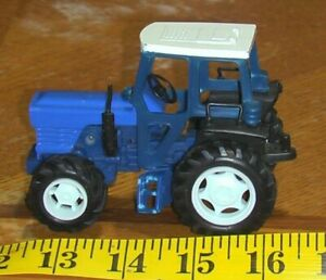 Ford Farm toy Tractor Friction Drive 1/43  diecast and plastic