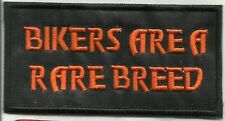 Sew On Patch of Ride Free with Orange Lettering Brand New