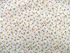 Coupon tissu Imprimé Fleurs Jaunes et Oranges sur fond Blanc 60x40cm