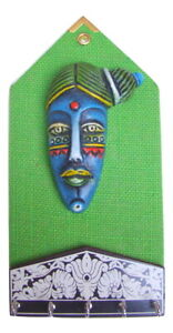 Key Holder Hook Peg on Wood Base over Decorative Mural with Tribal Face on Matty