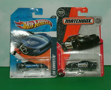 Two 1/64 Scale Chevrolet Corvette Diecast Police Cars - Matchbox and Hot Wheels