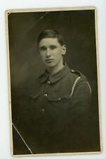 Handsome young soldier in military uniform .  RPPC real photo Postcard