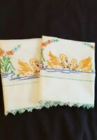 Vintage pair  Hand embroidered Pillowcases  crocheted hems  SWANS