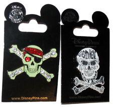 PIRATES OF THE CARIBBEAN Skulls lot of 2 Disney Park Pins Glow Dark Dead Men NEW