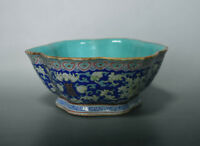 Late Qing foliated rim bowl with fencai floral scrolls on blue ground