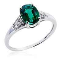 10k White Gold Ring with Emerald and Diamonds (G-H, 12-13)