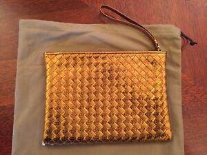 100% Authentic original Bottega Veneta bag in gold leather and sea snake skin