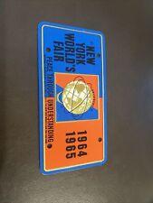 "1964 -- 1965 New York World's Fair  Mini License Plate  2"" X 4"" Raised Unisphere"